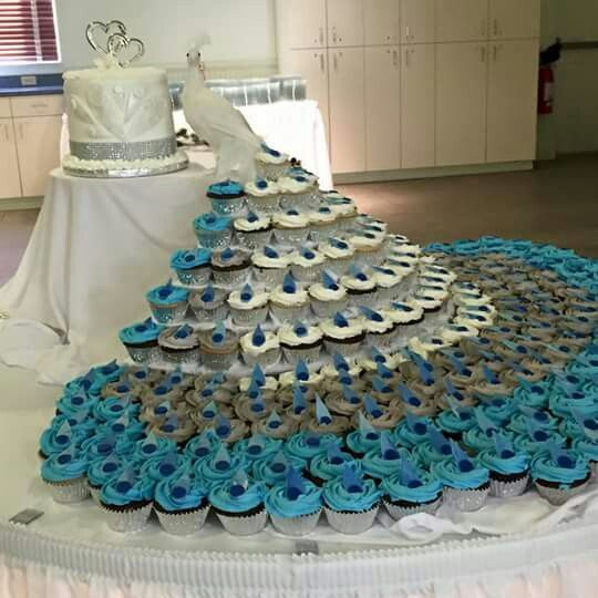 Cupcake cake wedding in the shape of a peacock